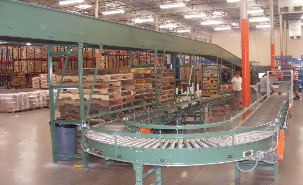 Conveyor for packing process in growing clothing accessory distribution center in Dallas TX